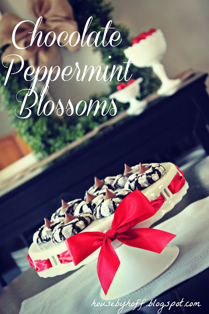 Chocolate peppermint blossoms poster, with the cookies on a cake stand and a red ribbon around it.
