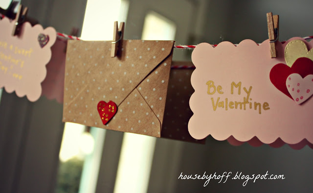 Polka dot, pink and ruffled envelopes hanging as a garland.