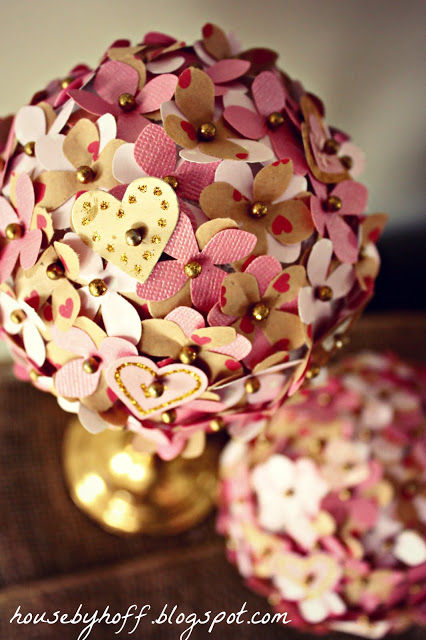Up close of the hearts and flowers pinned into a topiary.