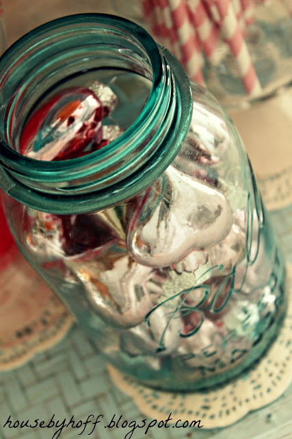 Up close picture of the soft green clear mason jar filled with hearts.