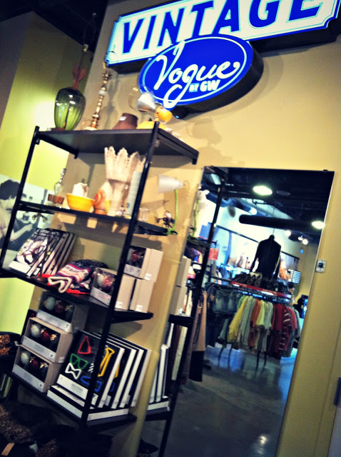 The inside of the vintage store with antiques and clothes.