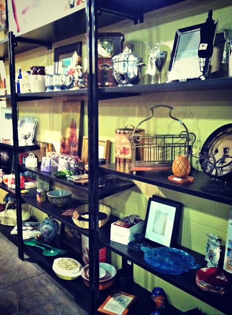 Items for sale on shelves in the vintage store.