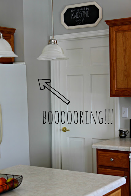 An arrow pointing to a boring plain wall in the kitchen.