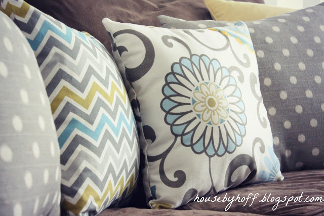 Floral, polka dot and zig zag patterned throw pillows.