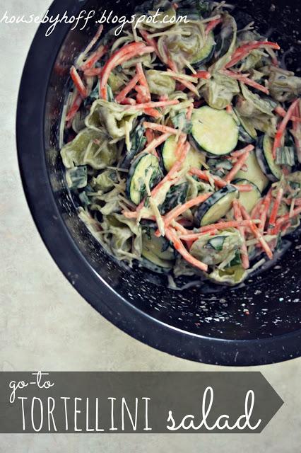 Totellini salad in a black bowl.
