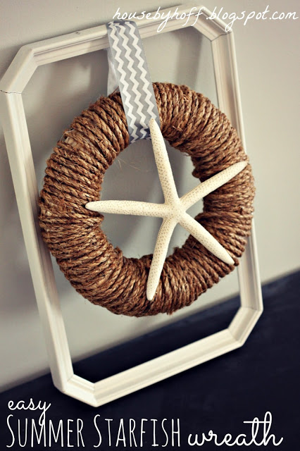 Starfish seashell wreath on a frame.