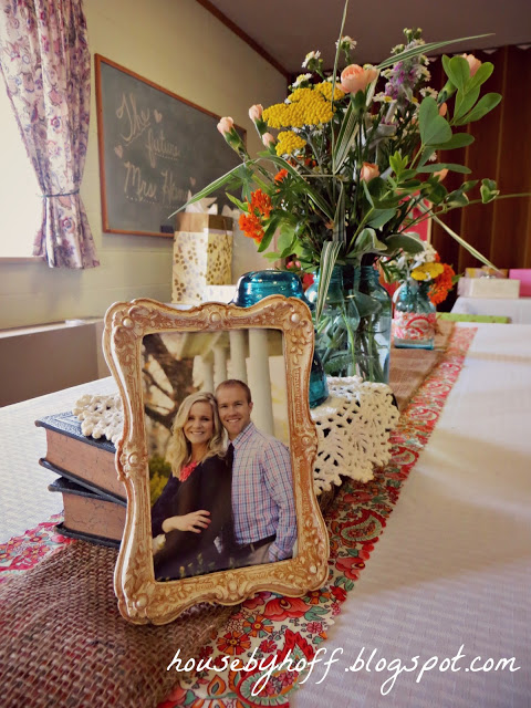 Vintage looking gold frame with the couple in it.