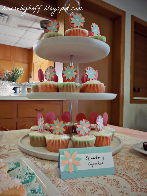 Decorated cupcakes on a stand.