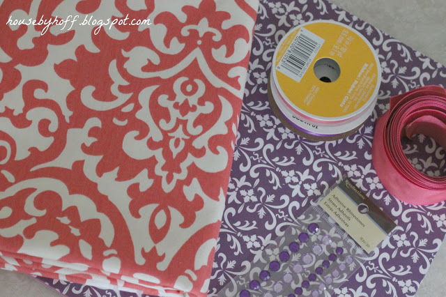 Purple and red graphic paper with decorations on the counter.