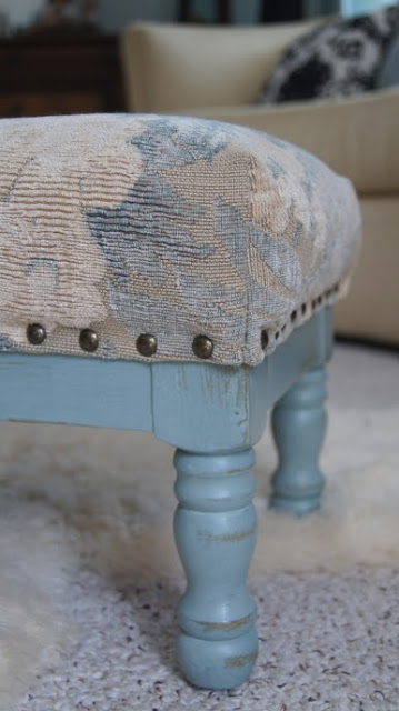 A blue distressed stool.