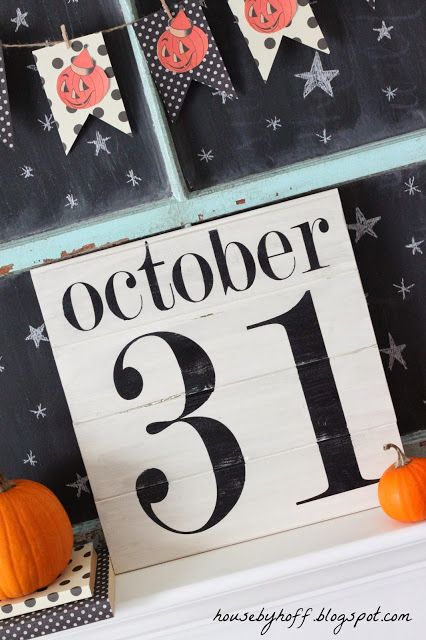 October 31, with a pumpkin garland above it and stars on a chalkboard.