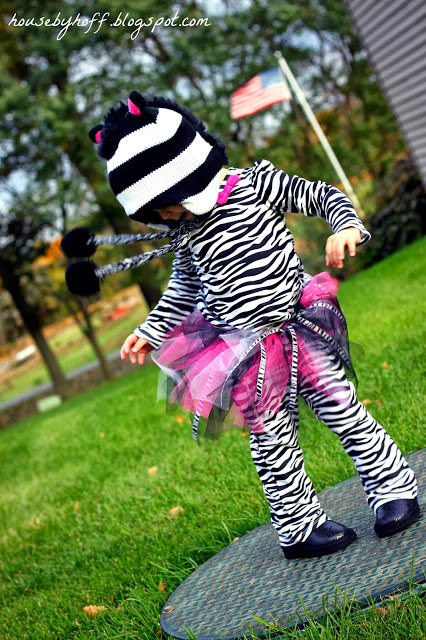 Little girl dancing in her zebra costume.