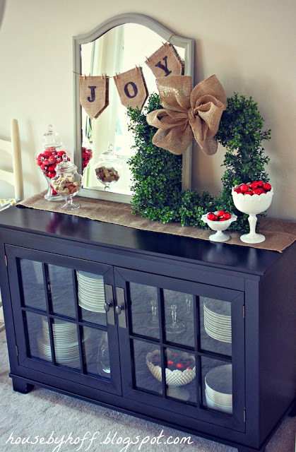 The Christmas wreath on a cabinet.