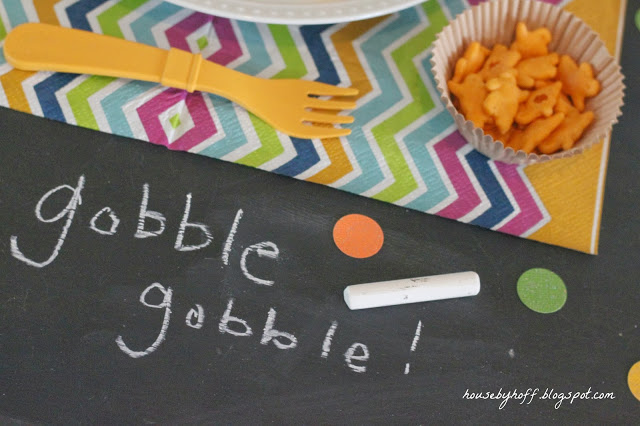 Gobble gobble written in chalk on the table.