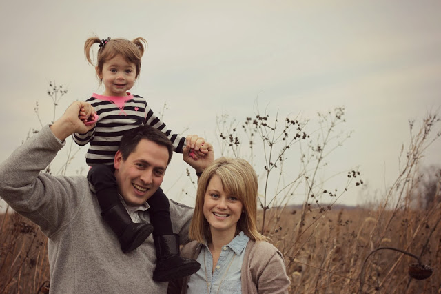The little girl on Daddy's shoulders in the picture.