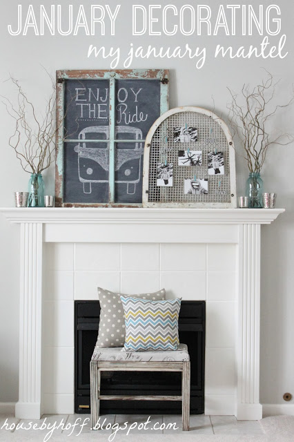 A fireplace with a bench and pillows in front of it and a chalkboard with a bus drawn on it.