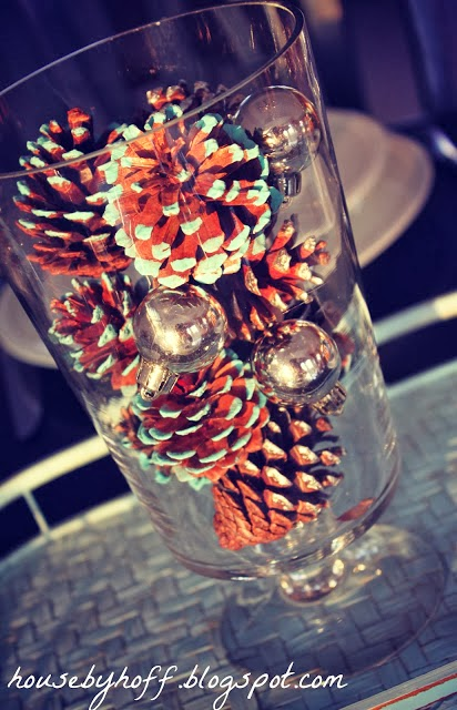 The painted pine cones in a clear glass vase.