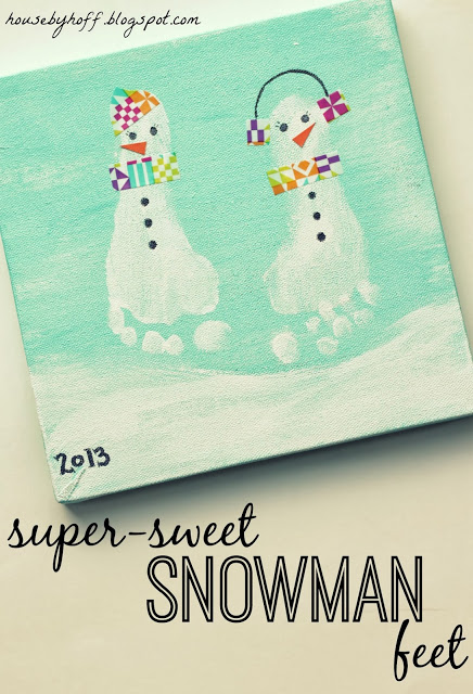 A child's artwork, her feet turned into snowmen.