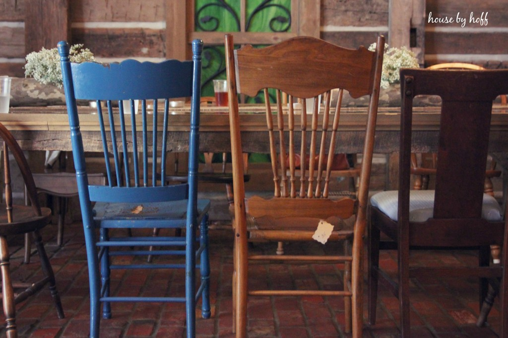 Colourful chairs in the barn at the table.