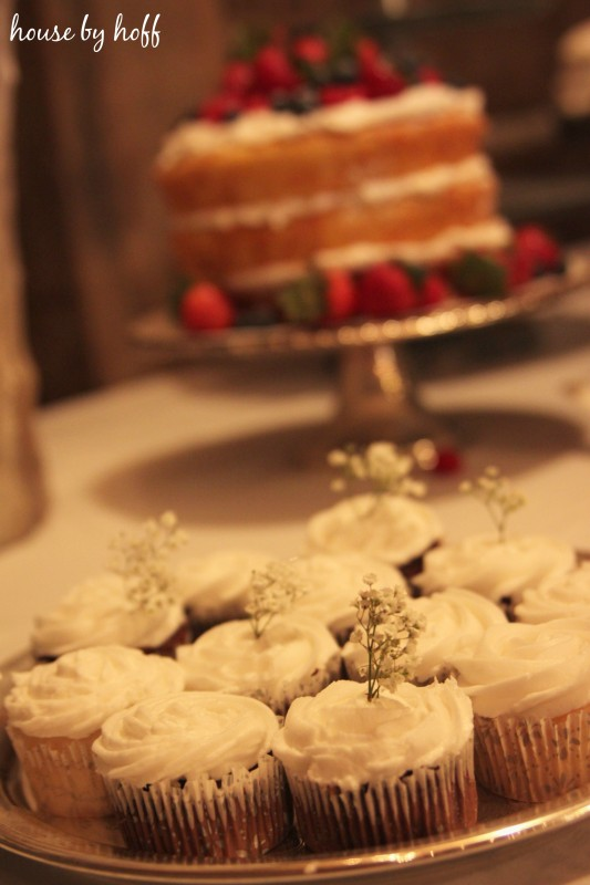 Vanilla cupcakes with a sprig of baby's breath.