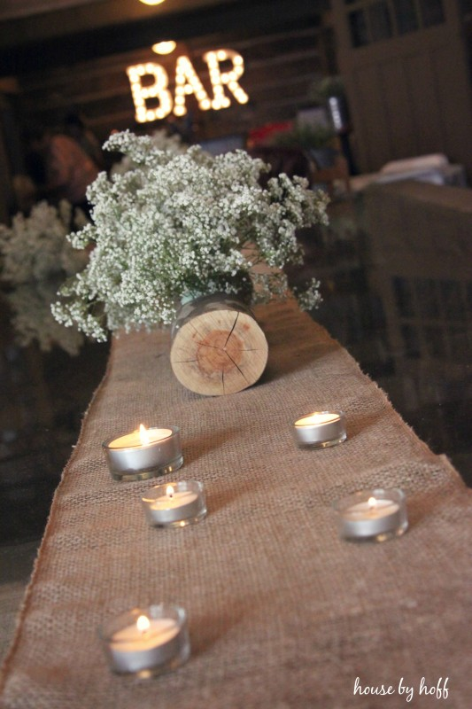 Baby's breath on table with tea lights.