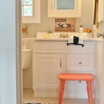 Preppy-Coastal-Bathroom-Makeover-touches-of-Coral-Navy-mixed-with-fun-prints-682x1024