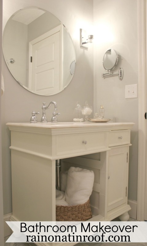 All white bathroom with large mirror above vanity.