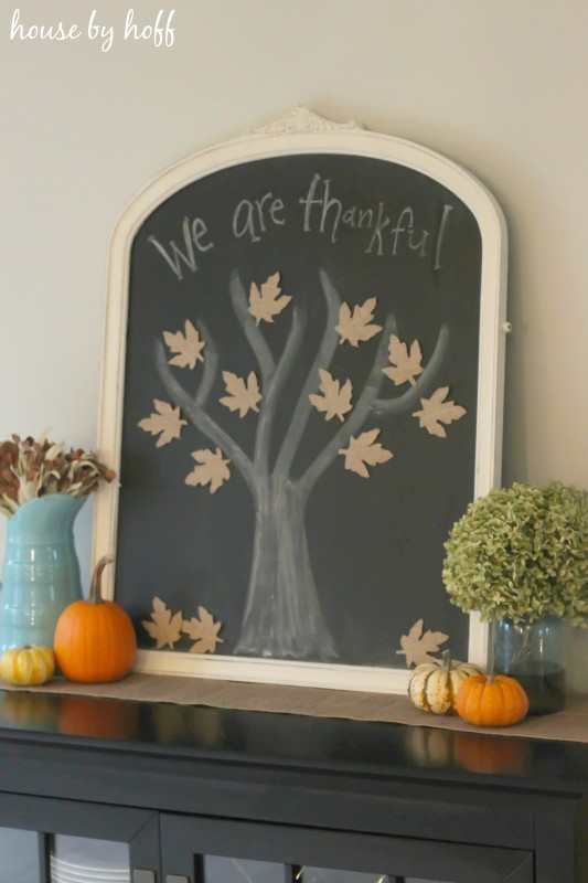 Chalkboard Tree with Burlap Leaves and pumpkins on the hutch in dining room.