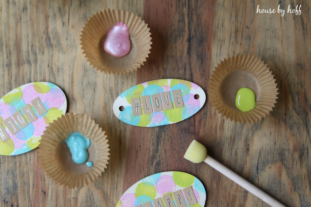 The personalized gift tags with a paint brush and paint.