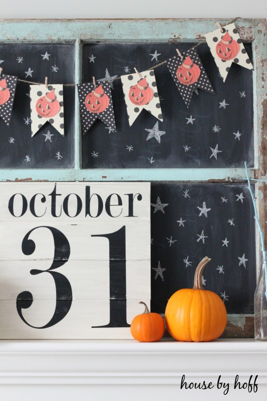 DIY Halloween Sign October 31, with pumpkins and a pumpkin garland on the mantel.
