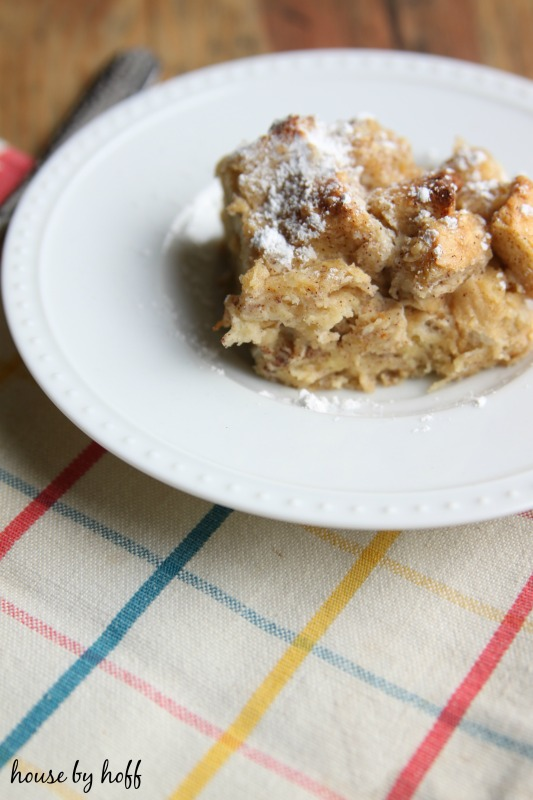 French toast casserole on a plate with a sprinkle of icing sugar on top.