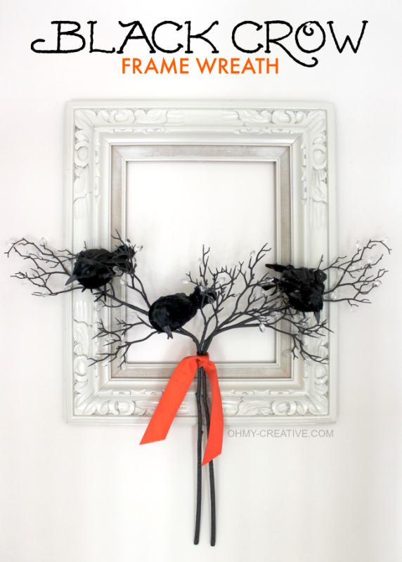 Black crows in front of antique mirror on a branch.