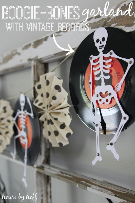 Skeleton on a record, hanging up on the wall.