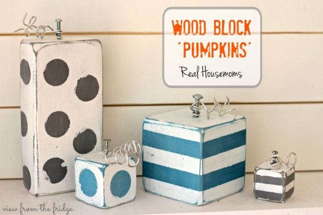 Wood block pumpkins in white and blue and black.