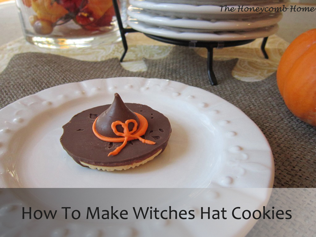 Witches hat cookies with brown hats and orange trim.