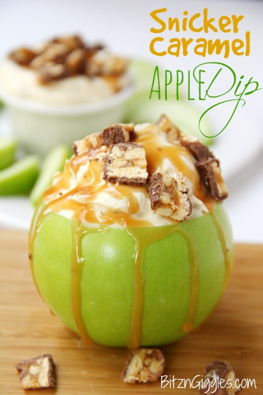 Snicker caramel dipped apple with the caramel oozing down the side.