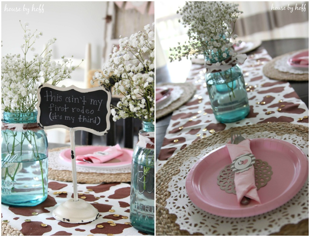 Pink plates and cowhide runner on table.