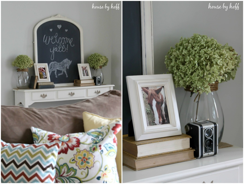 Horse pictures in frames on side table.