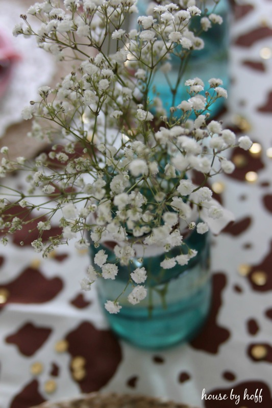 Blue mason jar with baby's breath inside.