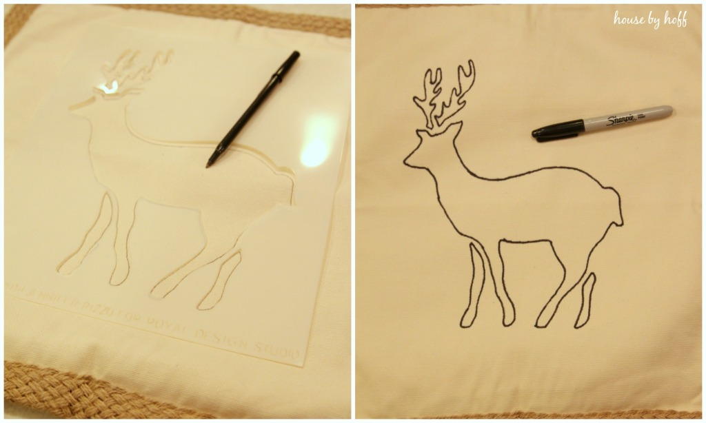 The reindeer stencils on the table with a pen.