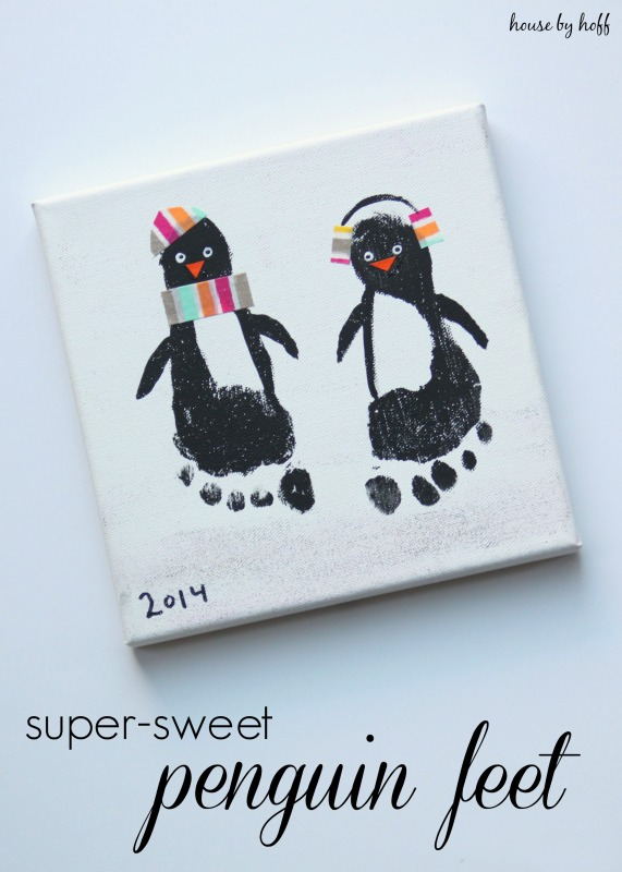 White canvas with black penguin footprints.