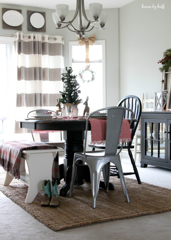 The dining room table with a small Christmas tree centerpiece.