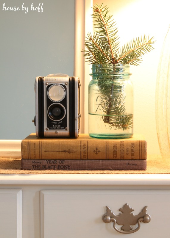 An antique camera on vintage books.