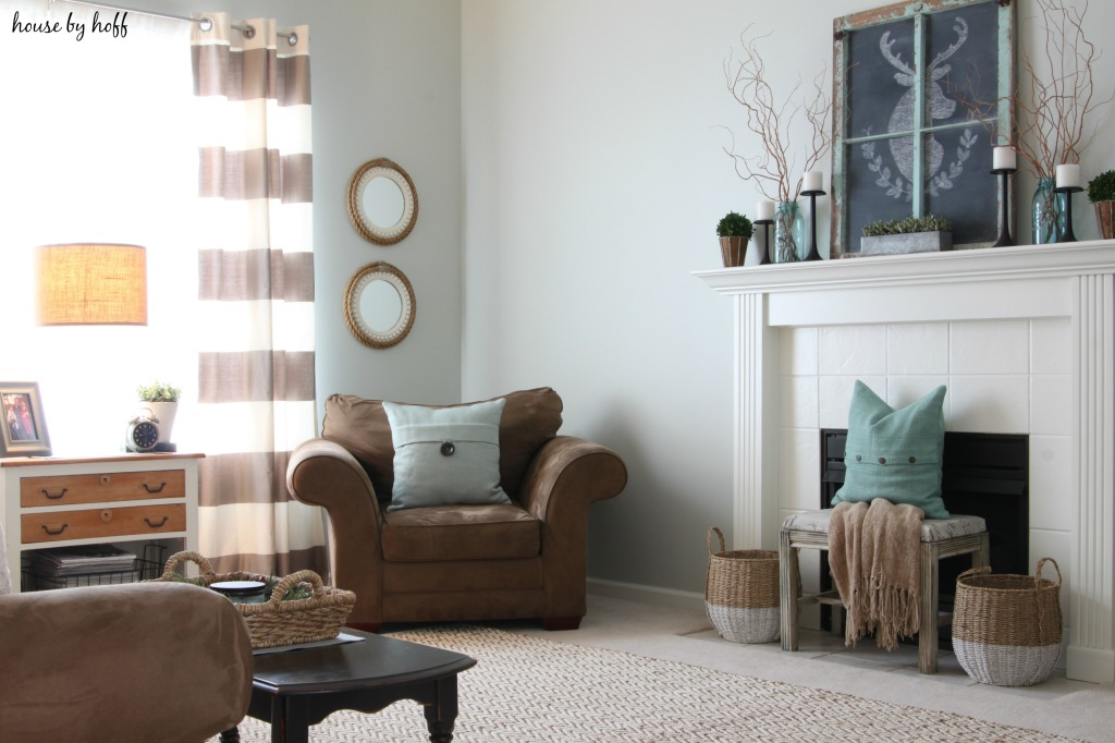 Brown couches and blue pillows in the living room.