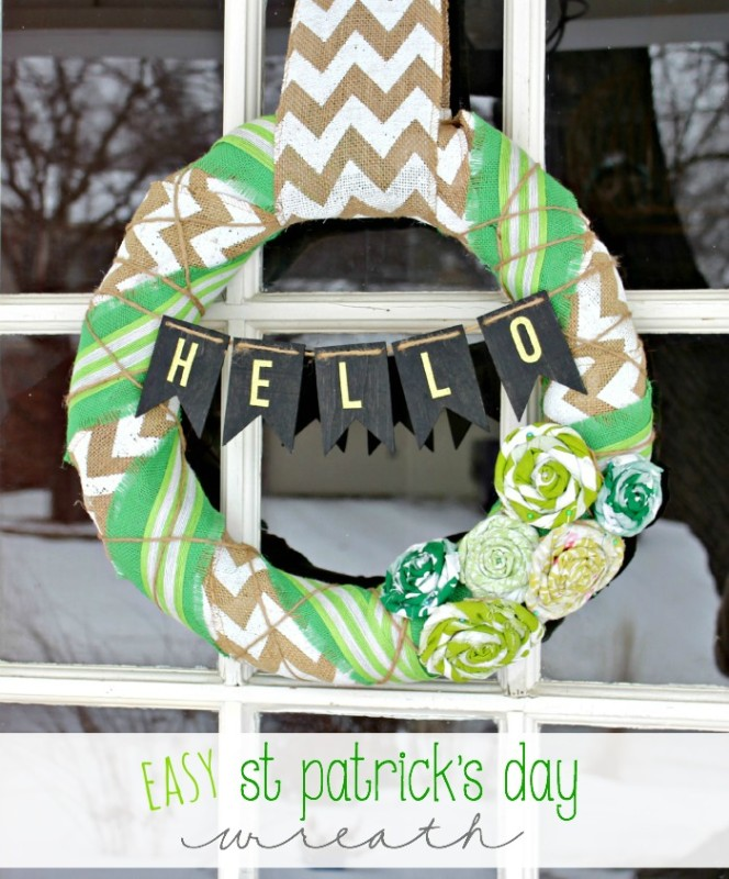 A St. Patrick's inspired wreath hanging in the window.