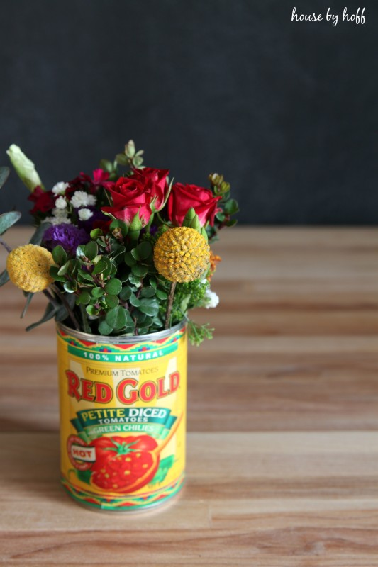 Vibrant floral bouquet in a tin can.