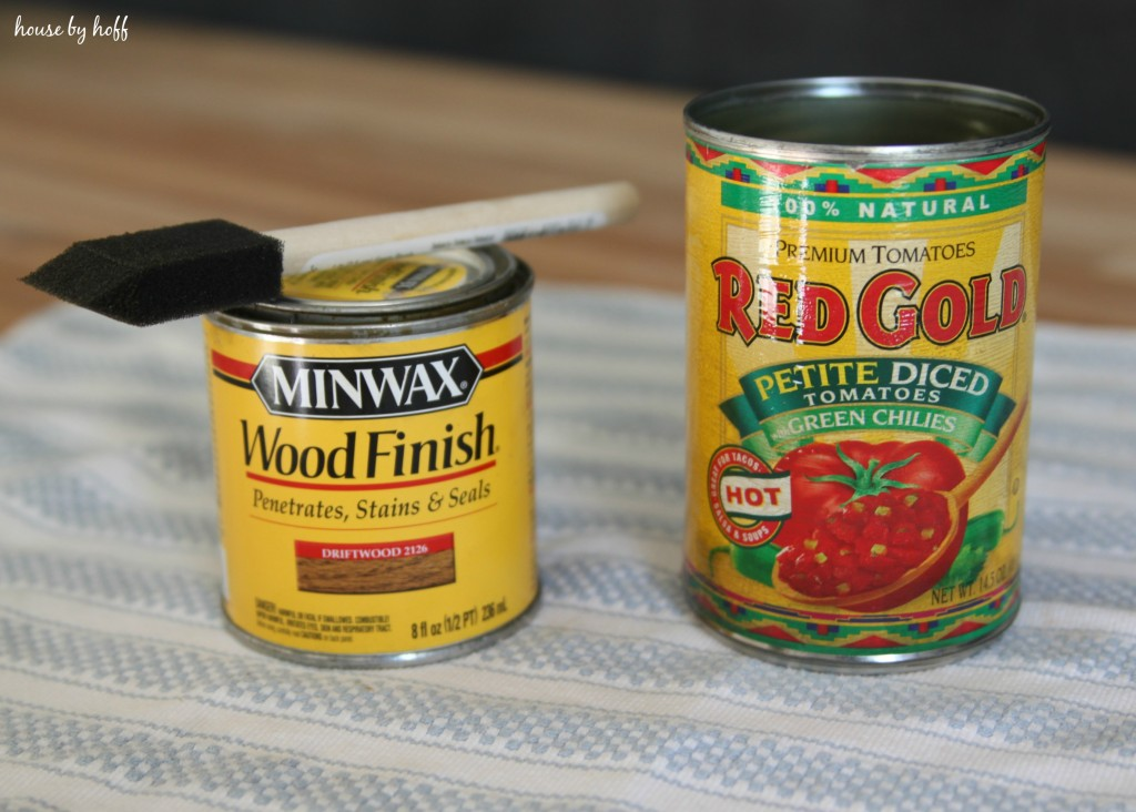 The tin can on the table beside a can of finish minwax.