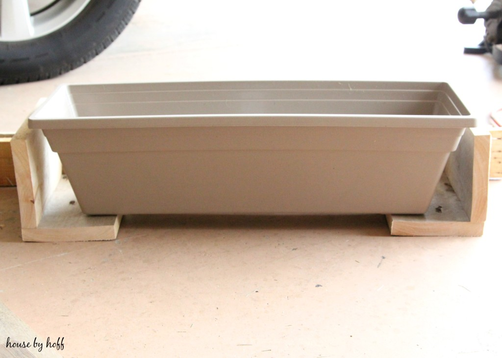 Rectangular plastic planter box.