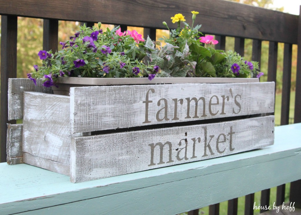 Planter box with the words farmer's market on it.