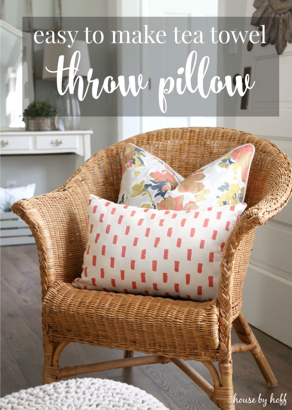 Wicker chair with 2 throw pillows on it.